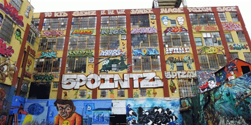 5-Pointz graffiti museum in Long Island City (a building covered in graffiti, with 5POINTZ prominently on it)