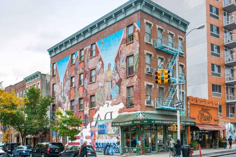 Image of building with artist mural for harlem ren 100